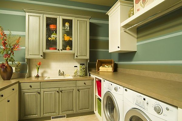 Green laundry room with traditional cabinets