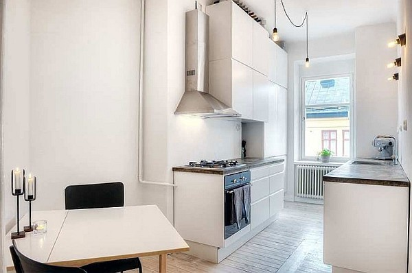One Bedroom Apartment Stockholm 4 – white kitchen with medieval accents