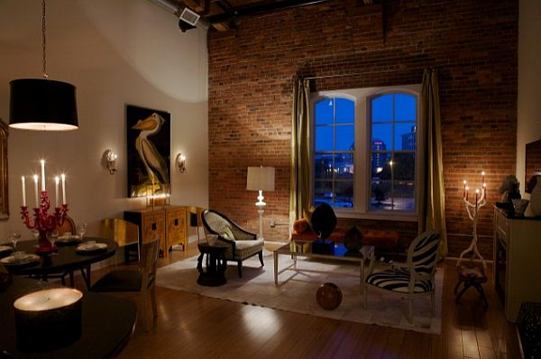 beautiful living room with exposed brick wall against white wall