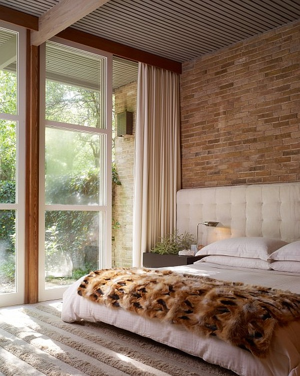 bright bedroom with exposed brick walls