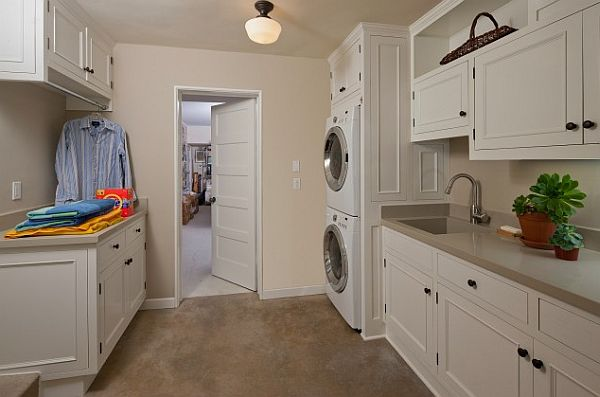white modern laundry room with Cupboards and hanging rack
