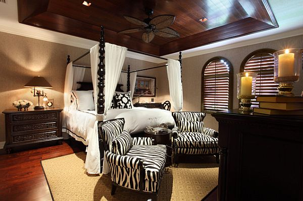 Beautiful african inspired bedroom with an ornamental canopy bed