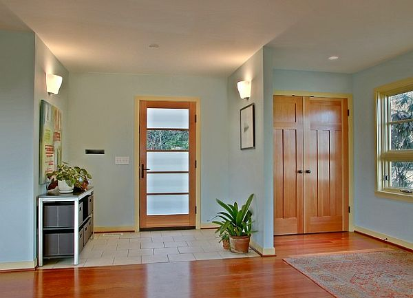Full light glass entry door with wood trim in a very inviting entryway