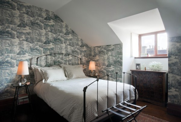 A guest room with a luggage rack