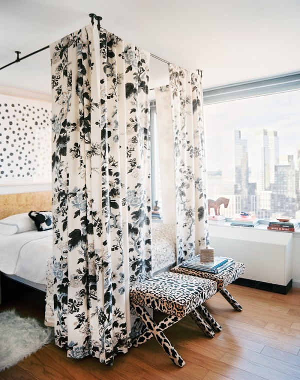 a bed with curtains feng shui