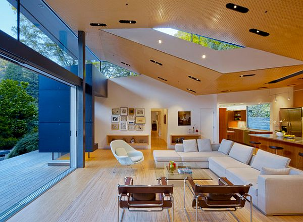 highly modern open living room design with glass wall