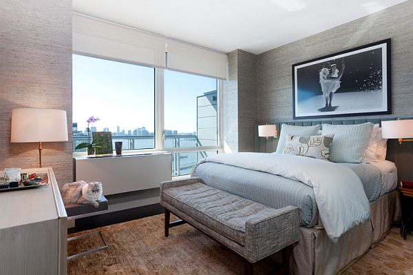 modern NYC bedroom with textural grass cloth wall covering and soft blue bedding