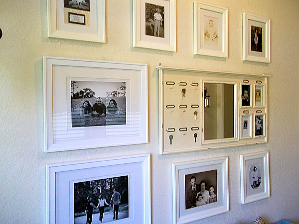 wall gallery of familiy pictures with white frames