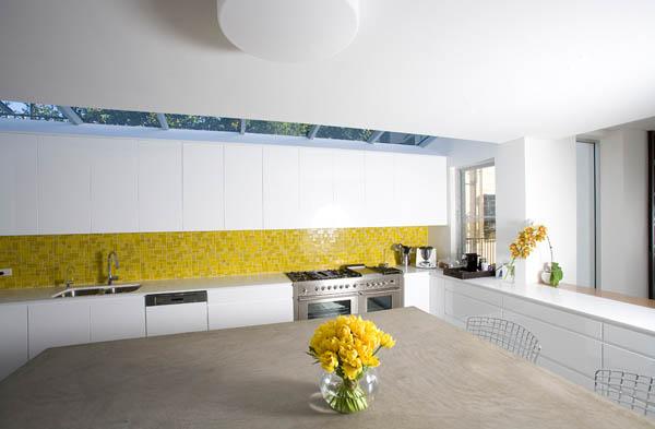 white kitchen design with yellow tiles