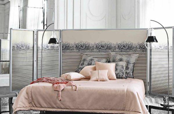 A designer metal screen bed by Jean Paul Gaultier