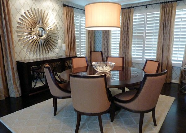 glamorous dining room with sunburst mirror