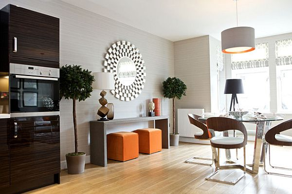 modern living room furniture and a sunburst mirror