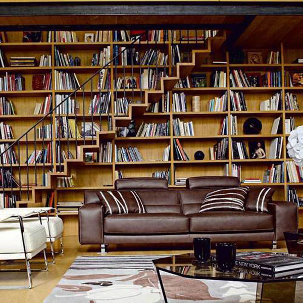 Creative home library design the integrates the stairs in its visual appeal