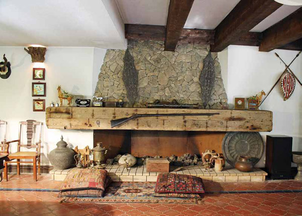 Fireplace laced with antiques and collectables