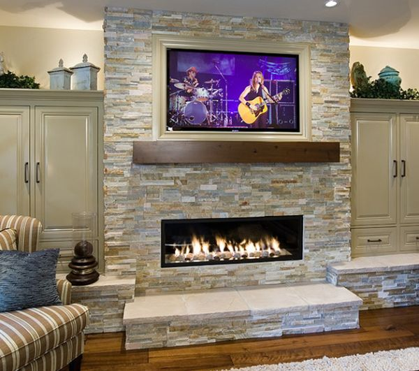 Linear fireplace with a flat screen TV on top