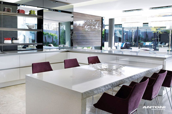 Opulent modern home in Houghton – modern kitchen decor with white table and purple chairs