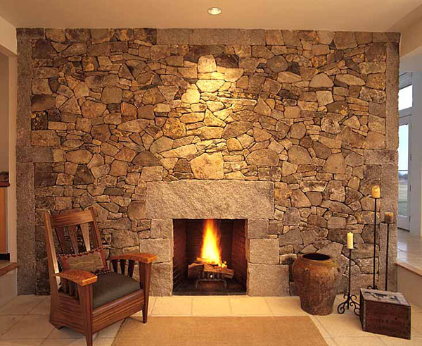 Unassuming Fireplace complemented by a stone wall