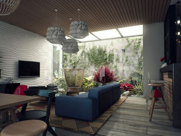 Vivacious living space that invites in nature supplemented by interesting skylight use