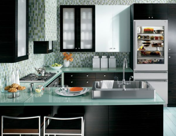 Fabulous kitchen in blue and green with a 30-inch wide integrated glass doo refrigerator