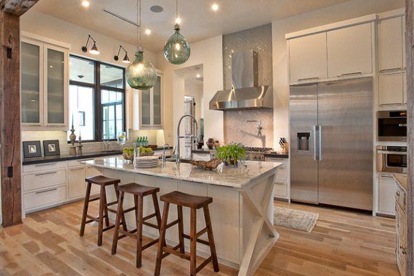 Multiple layers of smart lighting illuminate this eco-friendly kitchen