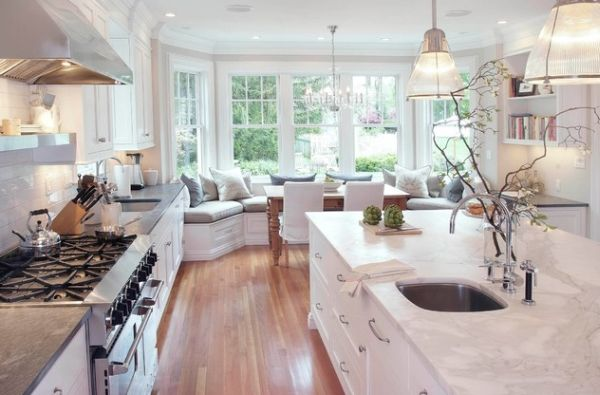 Stunning modern kitchen in pristine white where pendant lights take a rare backseat