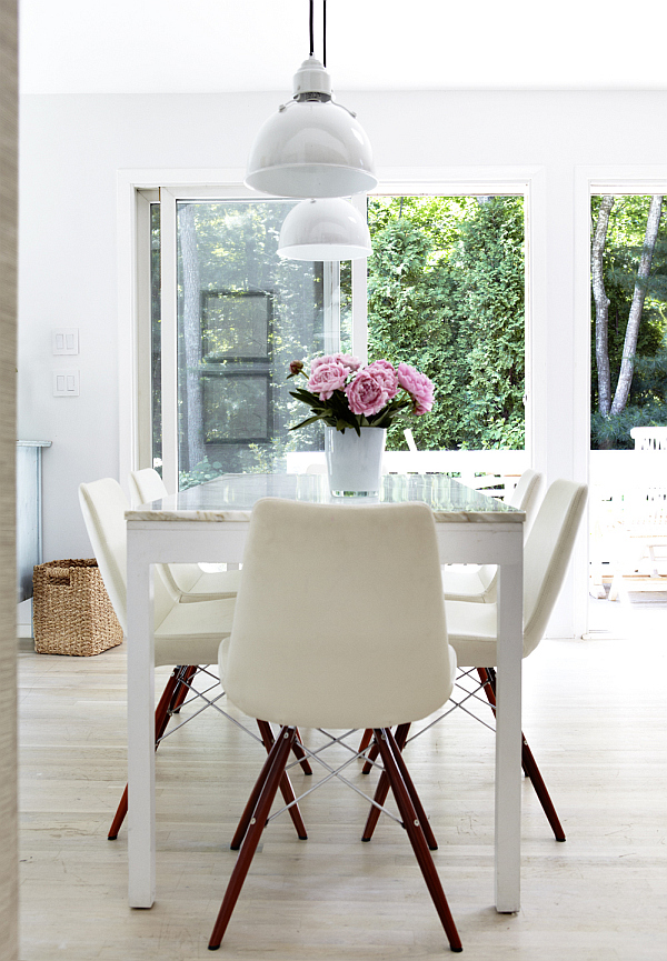 White dining room with purple flowers