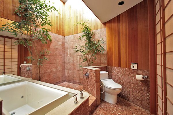 bathroom with an privacy wall for the toilet