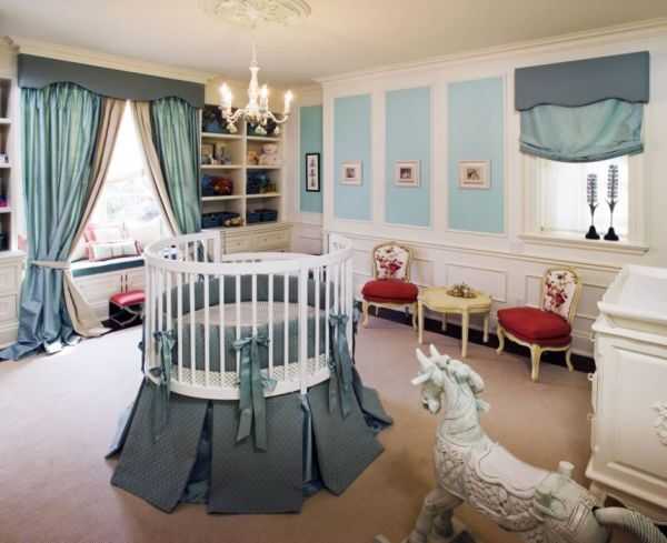 A round crib at the center of the room offers a complete view for the tiny tot