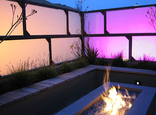 Creative lighting and a fire pit on a contemporary patio