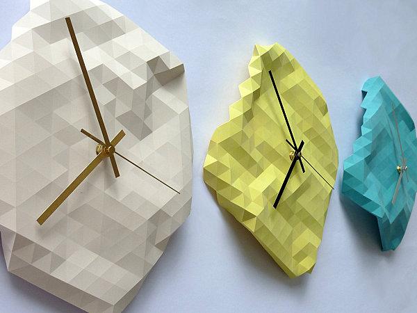 Geometric faceted wall clocks