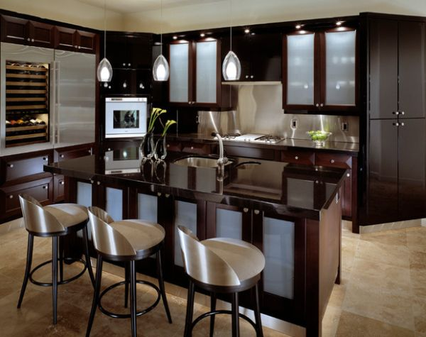 Gorgeous contemporary kitchen in dark hues brings in light, airy appeal with frosted glass door cabinets