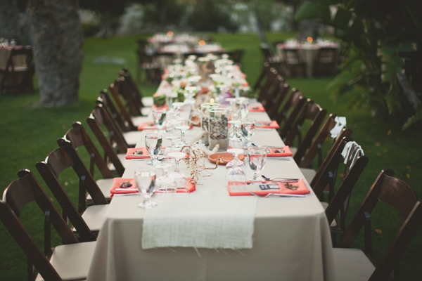 Long party table with neon napkins