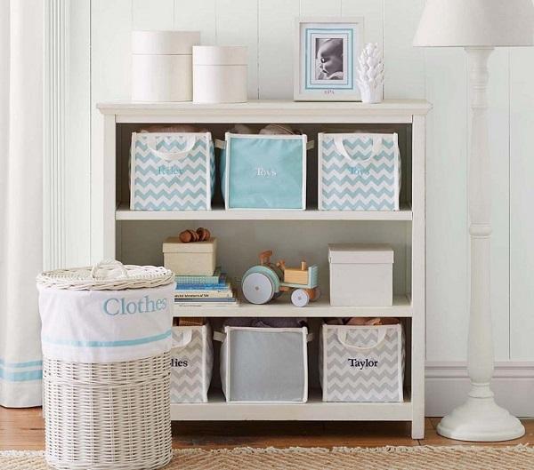 Monogramed canvas storage bins in bookcase
