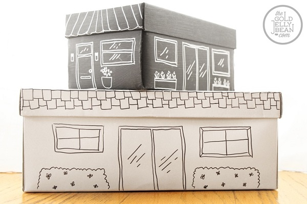 Shoe box toy storage with hand-drawn picture