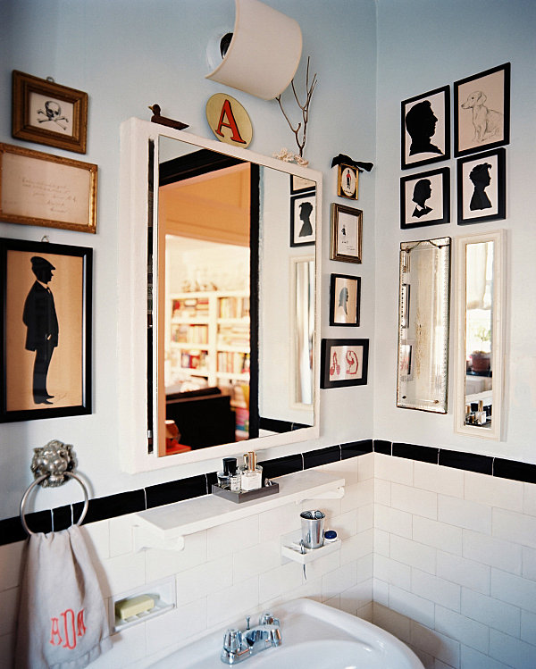 Silhouette artwork in a compact bathroom