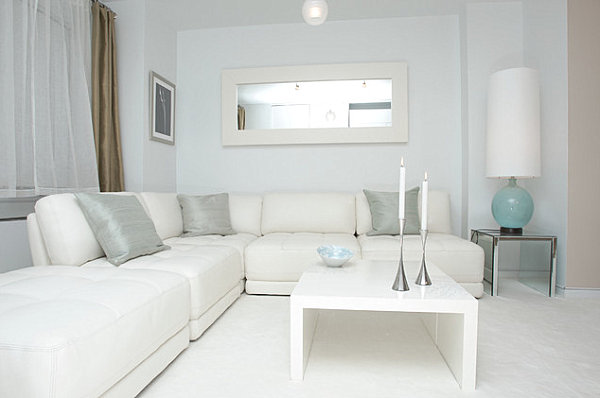 Sparse pastel accents in a gray and white room