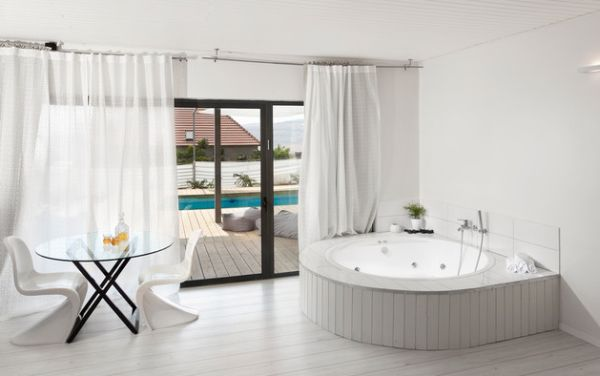 Contemporary bathroom in white with matching drapes and sliding glass doors