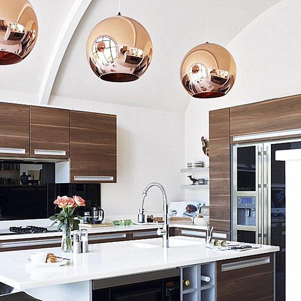 Copper pendant lights in a modern kitchen