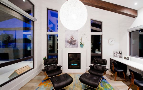 Decor and Eames loungers in dark shades bring contrast to the light background