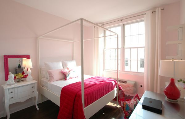 Beautiful bedroom in light pink accentuated by fabric and decor in hot fuchsia