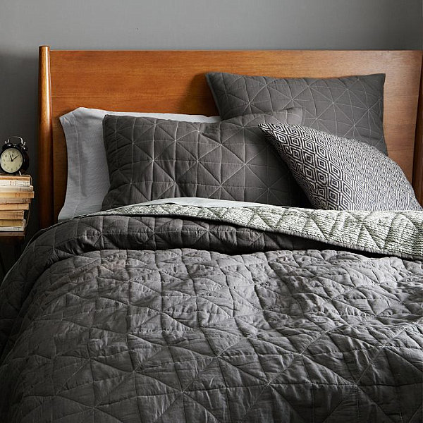 Gray quilted-style coverlet