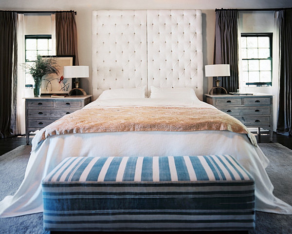 Master bedroom with a tufted headboard