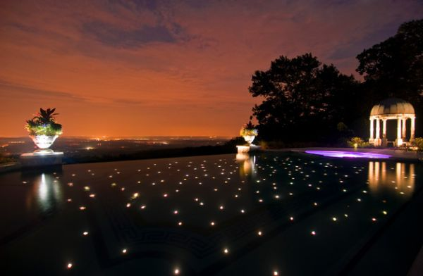 An infinity pool that appears to reflect a star-studded night sky