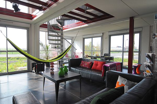 Beautiful shipping container home with a hammock in the living area