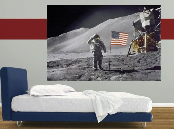 Bedroom in red, white and blue with a poster off the moon landing