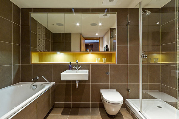 Brown bathroom with blue and gold details