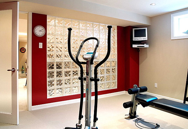 Contemporary home gym with glass block