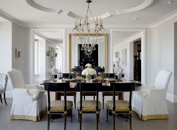 Modern dining space in white with a gash of golden hue