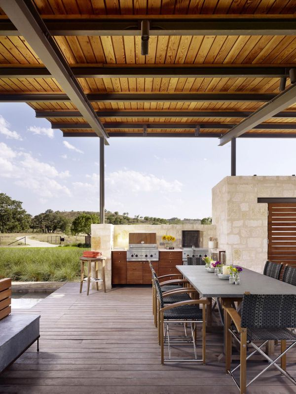 Open air kitchen and dining space of the Story Pool House