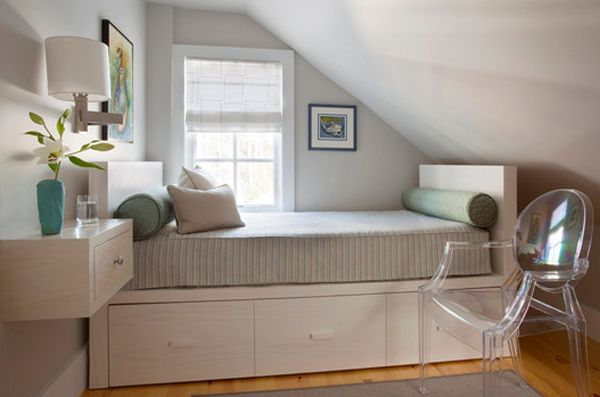 Storage underneath the bed and decor that does away with legs – Perfect for small bedrooms